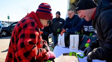 Doris Lax on Friday receives fresh produce at