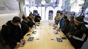 Shoppers check out the new Apple iPad mini
