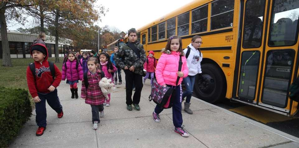 A school bus arrives Monday with students at