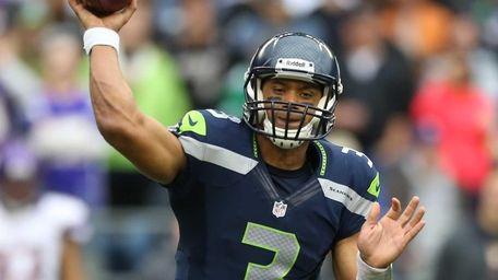 SEATTLE, WA - NOVEMBER 04: Quarterback Russell Wilson