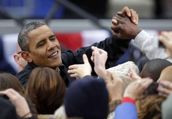 President Barack Obama greets supporters after speaking at