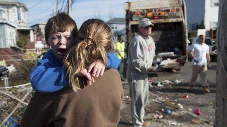 Aiden Guirl, 5, screams as his mother Kelly