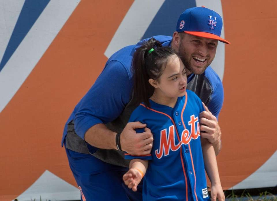 New York Mets player Tim Tebow poses for
