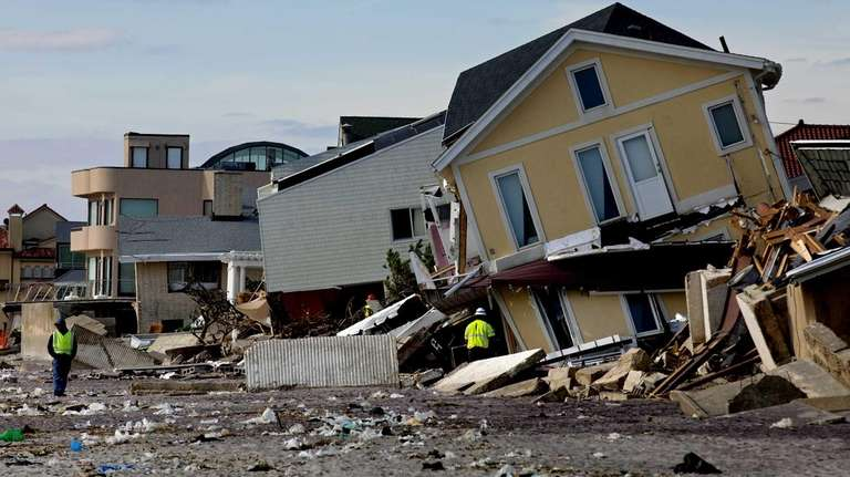 A home badly damaged by superstorm Sandy rests