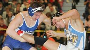 Hauppauge's Anthony DiBartolo (Blue) defeated teammate Luke Smith