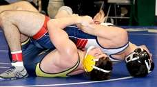 Massapequa's Jeremy Scutellaro controls MacArthur's Louis Calone from