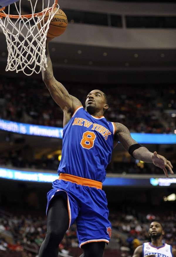 J.R. Smith dunks the ball during the first