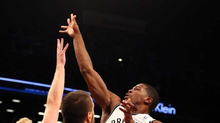 Joe Johnson of the Brooklyn Nets shoots over