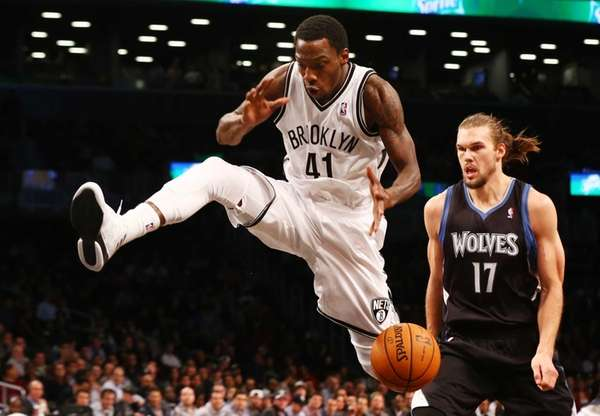 Tyshawn Taylor of the Brooklyn Nets loses the