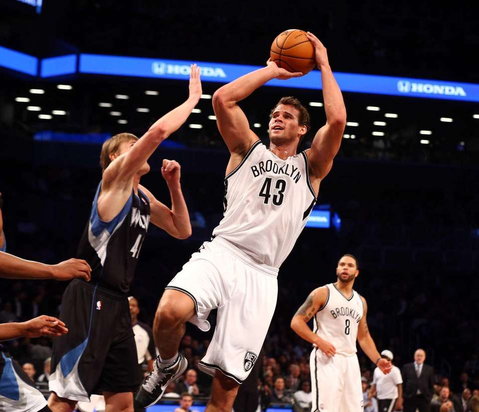 Kris Humphries of the Brooklyn Nets shoots against