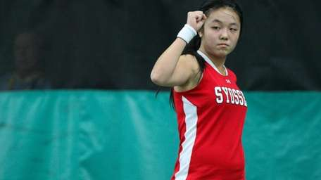 Syosset's Vivian Cheng fist pumps after getting a