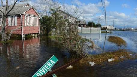 Flooding and debris caused by the surge from