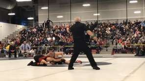 Eastport-South Manor's Zach Redding won via technical fall,