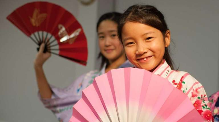 Nanami Horie, 7, of Port Washington, is joined