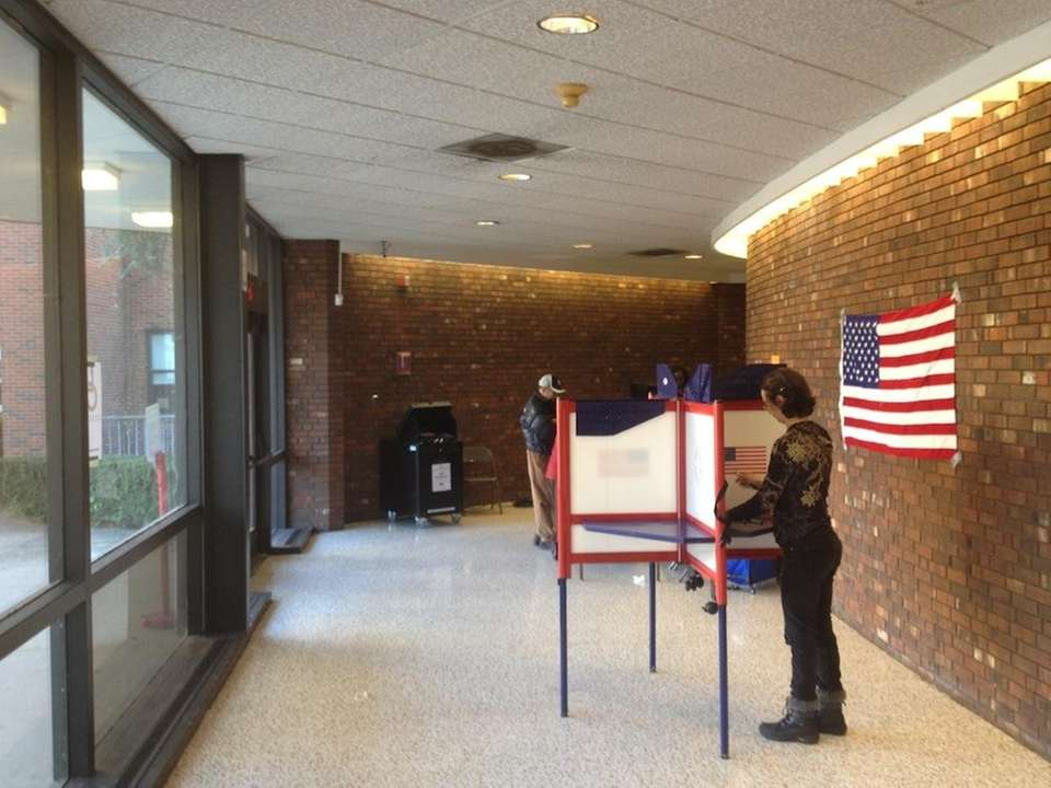 A woman votes at New Rochelle High School.