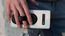 The Ohsnap phone grip attaches to the back