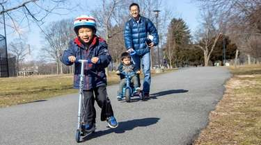 Leo Nagasawa, 4, of Port Washington, rides a