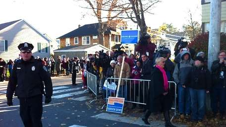 Security and lines at Mitt Romney's polling site