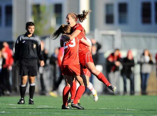 Stony Brook's Larissa Nysch leaps into the arms