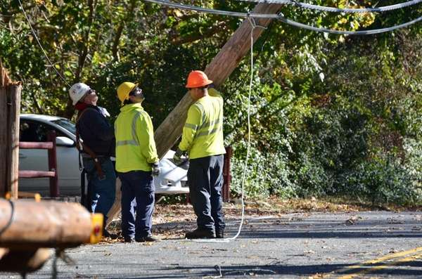 A LIPA crew works to replace a utility
