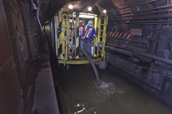 MTA employees work around the clock to pump
