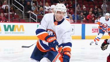 Andy Greene #4 of the Islanders skates with