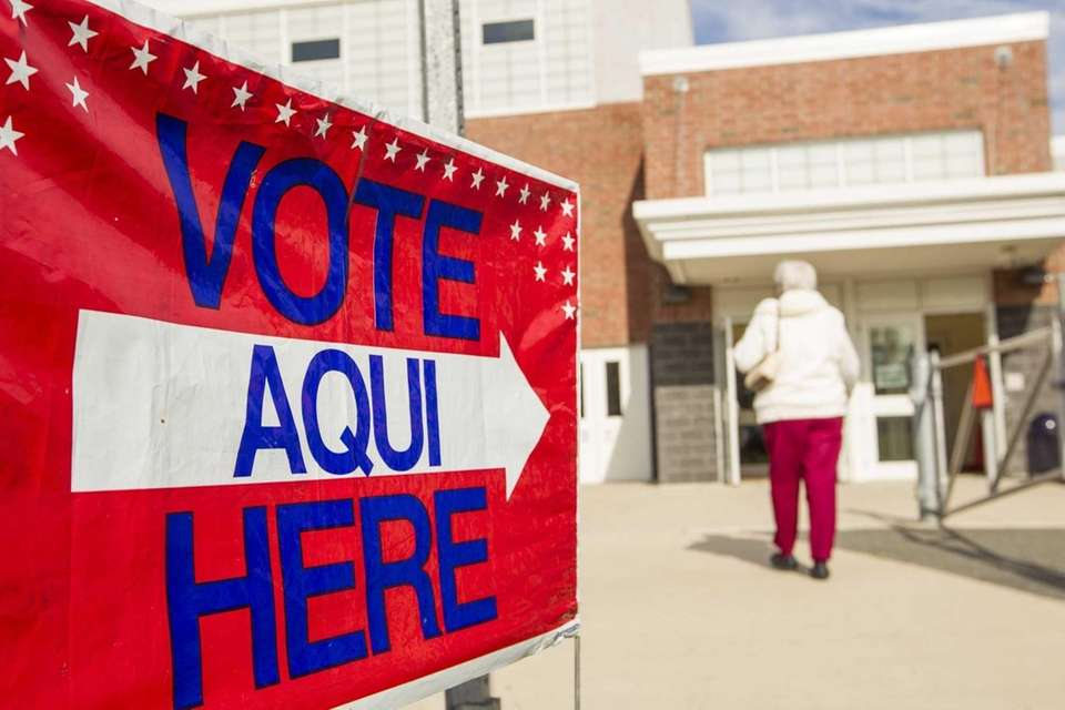 A voter enters Hampton Bays Middle School to
