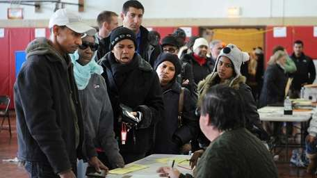 People line up to vote at Lindell School