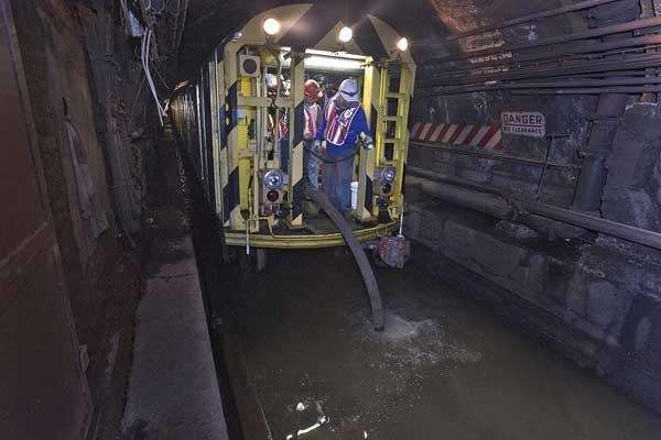 MTA employees pump seawater out of the L