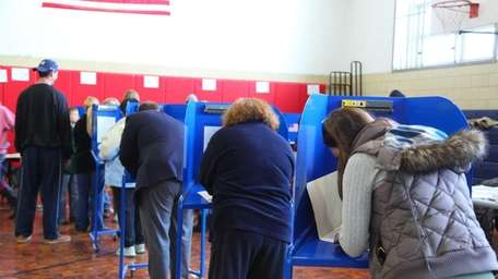 Voters turn out to cast their ballots at
