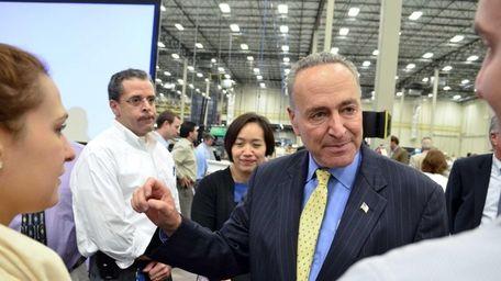 Sen. Charles Schumer (D-N.Y.) visits Broadridge's facility last