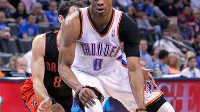 Oklahoma City Thunder guard Russell Westbrook (0) drives