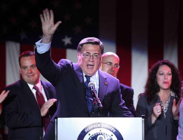 Republican Edward Romaine waves to his supporters at