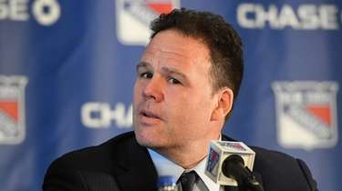 Rangers general manager Jeff Gorton looks on at