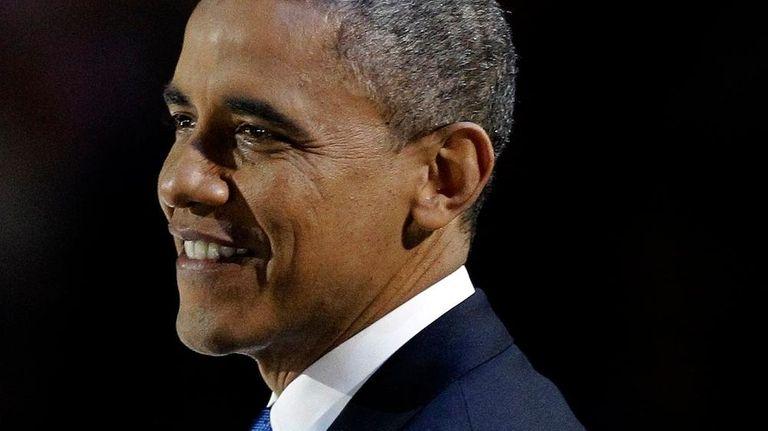 President Barack Obama smiles during his speech at