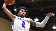Jayden Seraphin of Malverne goes up for a