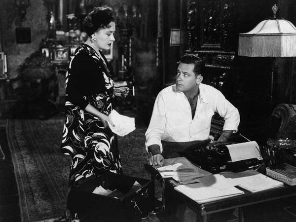 Gloria Swanson and William Holden, at right, are