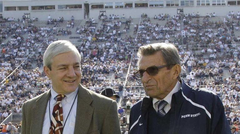 Penn State president Graham Spanier, left, and head