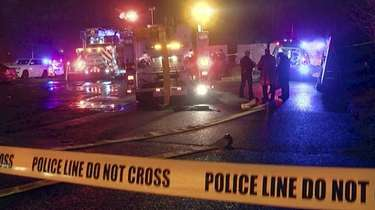 Investigators at the scene of an explosion in