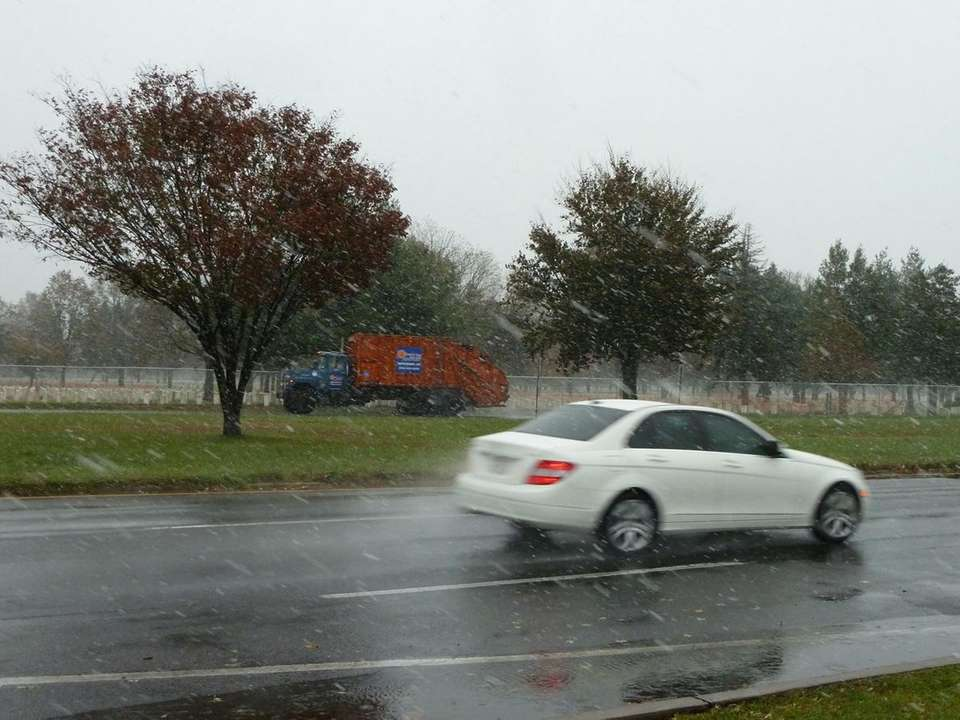 Snow falls on Pinelawn Road in Melville Wednesday