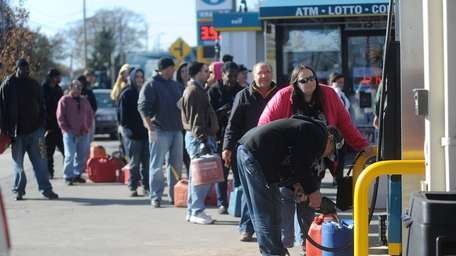 People line up with gas containers, some not