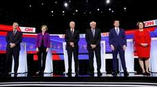 From left, Democratic presidential candidates businessman Tom Steyer,