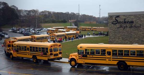 School busses line up outside of Sachem High