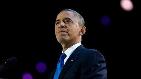 President Barack Obama pauses as he speaks at