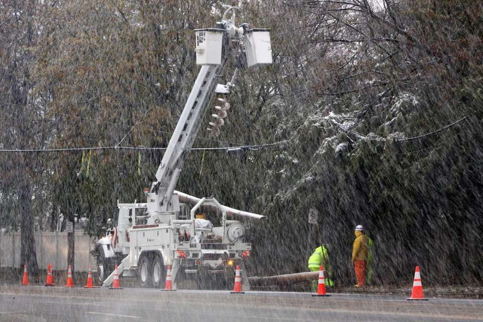 A crew from Xcel Energy works through the