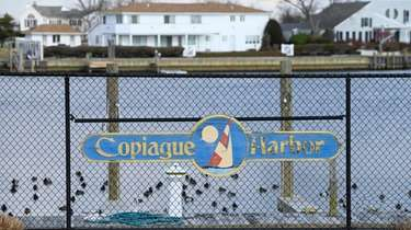Houses along Copiague Harbor seen from Lagoon Drive