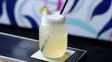 Margaritas are served in a mason jar with