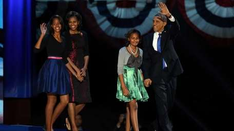 President Barack Obama walks on stage with first