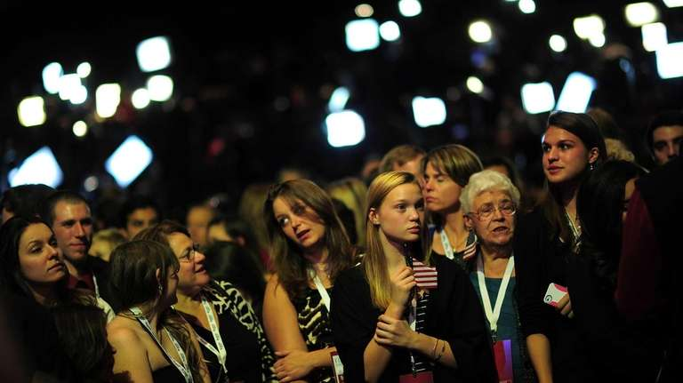 Supporters of Republican presidential candidate Mitt Romney react