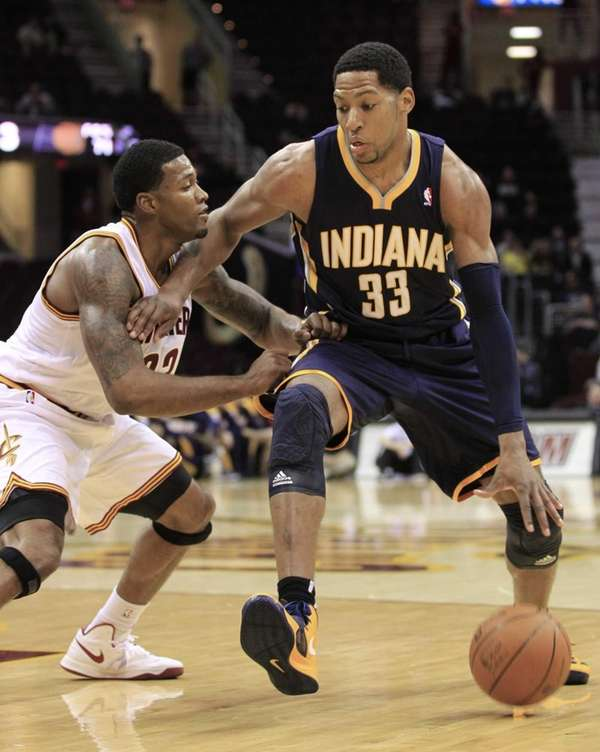The Indiana Pacers' Danny Granger, right, drives past